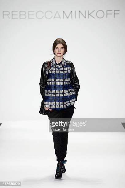 A model walks the runway at Rebecca Minkoff fashion show during MercedesBenz Fashion Week Fall 2014 at The Theatre at Lincoln Center on February 7...