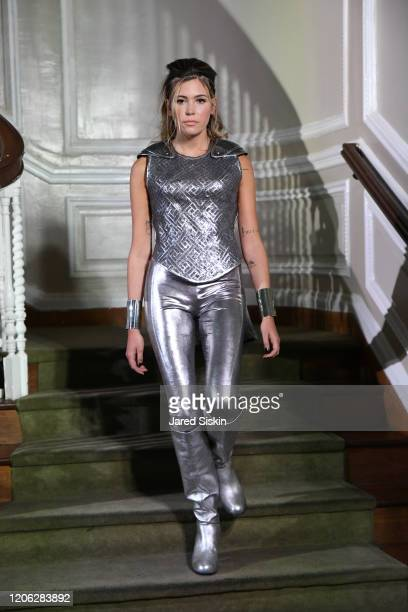 Model walks the runway at ROSSI TUXEDO New York Fashion Week Fall 2020 Collection at Consulate of Argentina on February 11 2020 in New York City