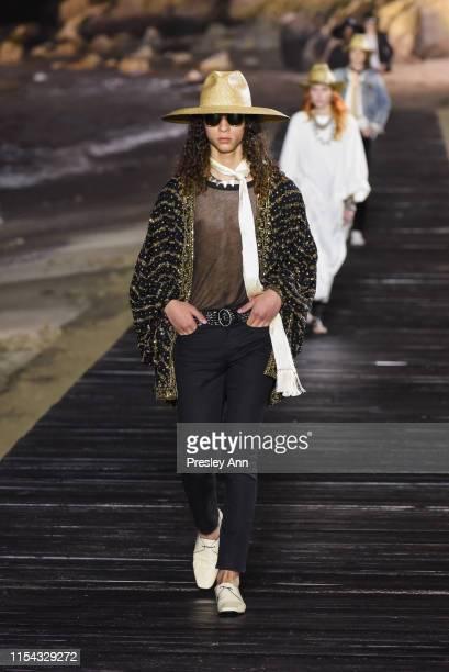 Model walks the runway at Saint Laurent mens spring summer 20 show on June 06, 2019 in Malibu, California.