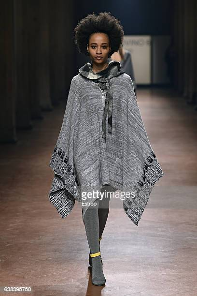 A model walks the runway at Sansovino 6 Show during Pitti Uomo 91 on January 11 2017 in Florence Italy
