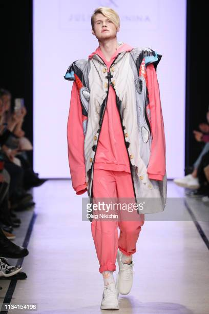 Model walks the runway at show of the Slava Zaitsev's Fashion Laboratory at Mercedes-Benz Fashion Week Russia A/W 2019/2020 at Manege on March 31,...