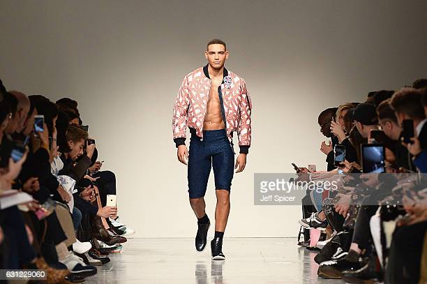 A model walks the runway at Sibling show during London Fashion Week Men's January 2017 collections at BFC Show Space on January 8 2017 in London...