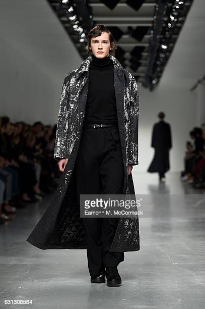 A model walks the runway at SONGZIO during London Fashion Week Men's January 2017 collections at BFC Show Space on January 9 2017 in London England