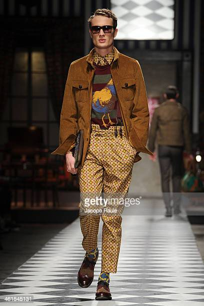 Model walks the runway at Stella Jean Fashion Show during Pitti Immagine Uomo 85 on January 9 2014 in Florence Italy