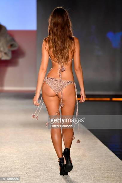 A model walks the runway at SWIMMIAMI Baes and Bikinis 2018 Collection at WET Deck at W South Beach on July 23 2017 in Miami Beach Florida