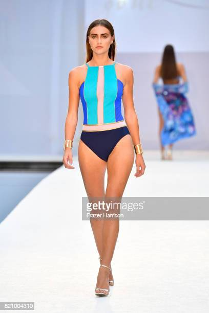 A model walks the runway at SWIMMIAMI Gottex Cruise 2018 Fashion Show at WET Deck at W South Beach on July 22 2017 in Miami Beach Florida