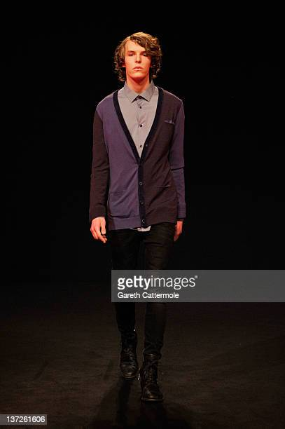 A model walks the runway at the 1913Berlin cashmere by Yujia zhaiPetrow Autumn/Winter 2012 fashion show during MercedesBenz Fashion Week Berlin at...