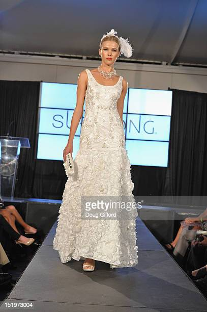 A model walks the runway at the 2012 Sue Wong 'Autumn Sonata' collection Fashion Show during the sixth annual Designer Runway event on September 13...