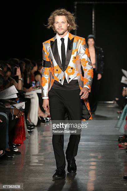 A model walks the runway at the 2015 amfAR Inspiration Gala New York at Spring Studios on June 16 2015 in New York City
