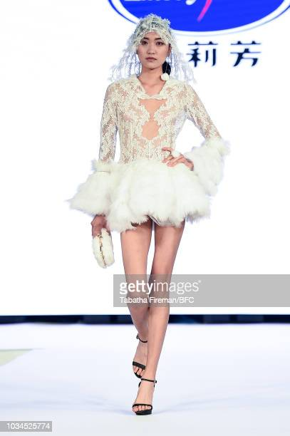 A model walks the runway at the 2018 Shenzhen Products Show during London Fashion Week September 2018 at the London Hilton on September 16 2018 in...