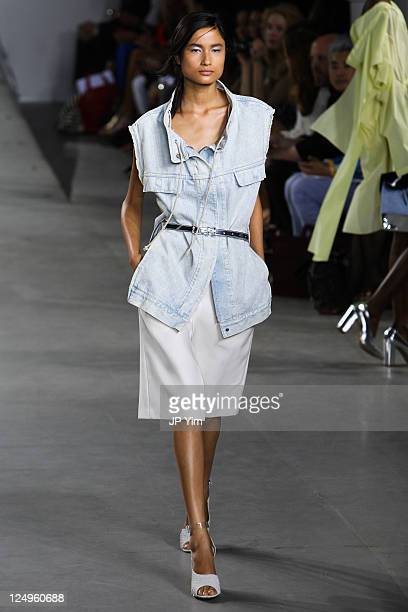 Model walks the runway at the 3.1 Phillip Lim 2012 fashion show during Mercedes-Benz Fashion Week at St. John's Center Studios on September 14, 2011...