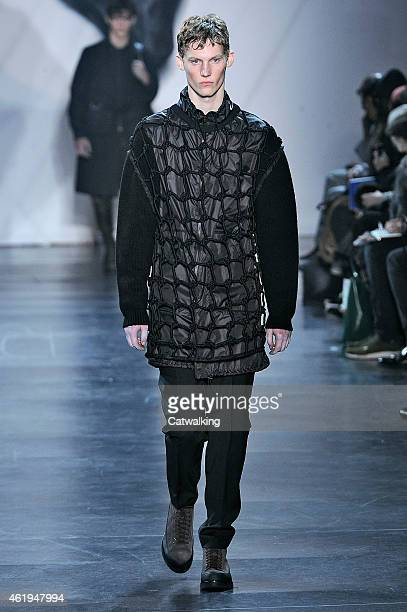 Model walks the runway at the 3.1 Phillip Lim Autumn Winter 2015 fashion show during Paris Menswear Fashion Week on January 22, 2015 in Paris, France.