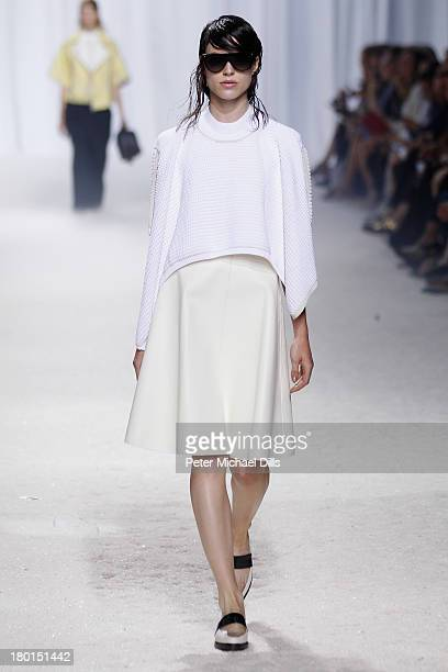Model walks the runway at the 3.1 Phillip Lim fashion show during Mercedes-Benz Fashion Week Spring 2014 on September 9, 2013 in New York City.