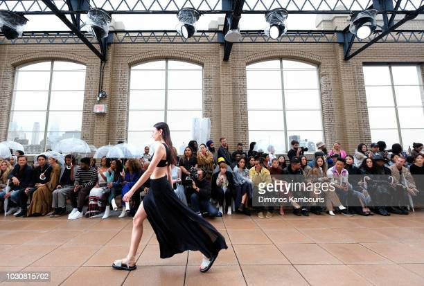 Model walks the runway at the 3.1 Phillip Lim front row during New York Fashion Week at New Design High School on September 10, 2018 in New York City.
