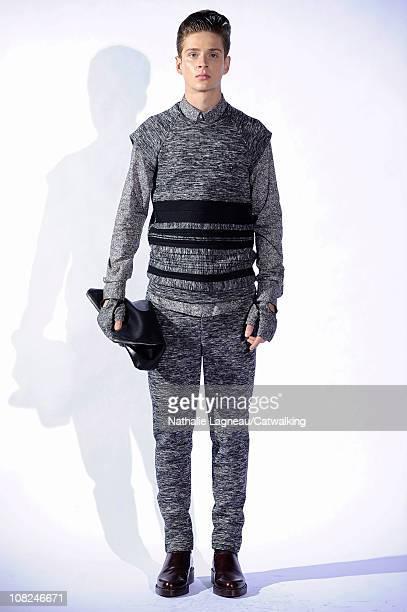 Model walks the runway at the 3.1 Phillip Lim menswear fashion show during Paris Fashion Menswear Week on January 22, 2011 in Paris, France.