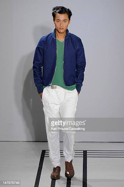 Model walks the runway at the 3.1 Phillip Lim Spring Summer 2013 fashion show during Paris Menswear Fashion Week on June 28, 2012 in Paris, France.