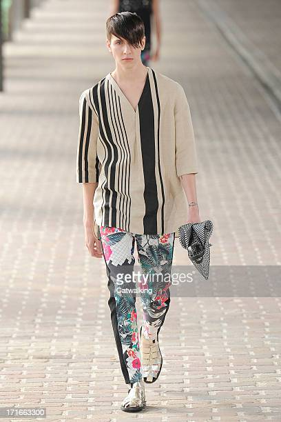 A model walks the runway at the 31 Phillip Lim Spring Summer 2014 fashion show during Paris Menswear Fashion Week on June 27 2013 in Paris France