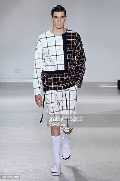 Model walks the runway at the 3.1 Phillip Lim Spring Summer 2015 fashion show during Paris Menswear Fashion Week on June 26, 2014 in Paris, France.