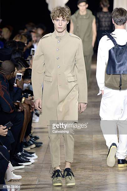 Model walks the runway at the 3.1 Phillip Lim Spring Summer 2016 fashion show during Paris Menswear Fashion Week on June 25, 2015 in Paris, France.