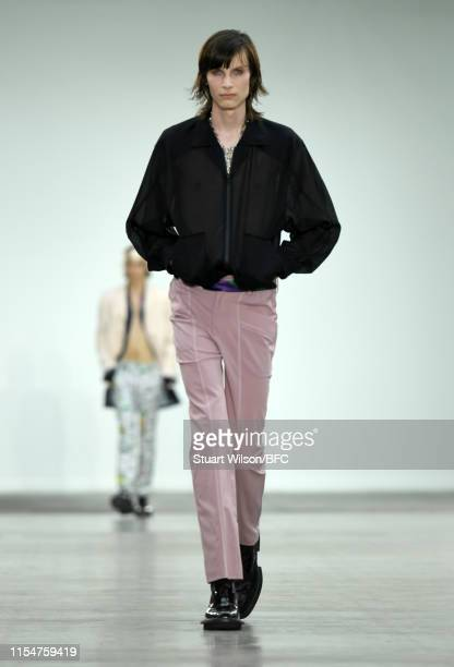 A model walks the runway at the 8ON8 Presented by GQ show during London Fashion Week Men's June 2019 at the BFC Show Space on June 09 2019 in London...