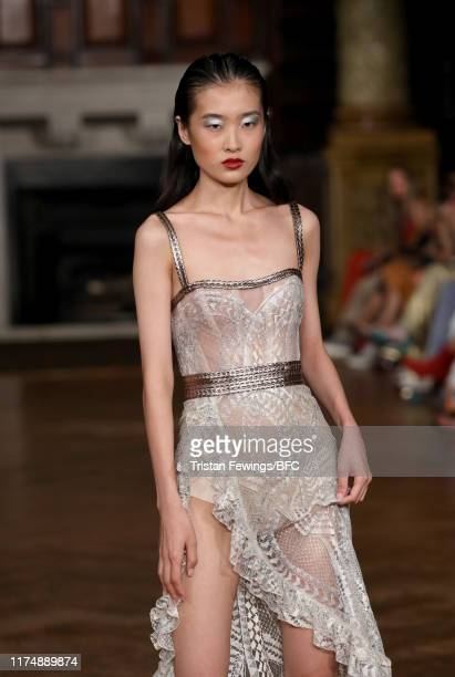A model walks the runway at the AADNEVIK show during London Fashion Week September 2019 at The Royal Horseguards on September 15 2019 in London...