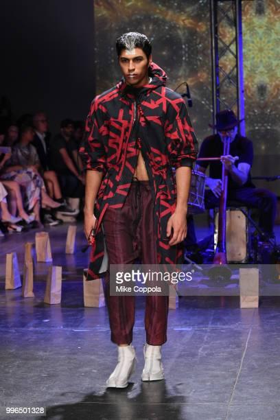 A model walks the runway at the Abasi Rosborough show Runway July 2018 during New York City Men's Fashion Week at Industria Studios on July 11 2018...