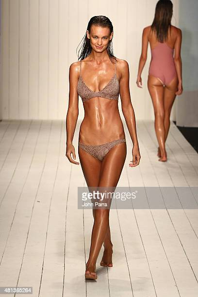A model walks the runway at the Acacia fashion show during FUNKSHION Fashion Week Miami Beach Swim at the FUNKSHION Tent on July 19 2015 in Miami...