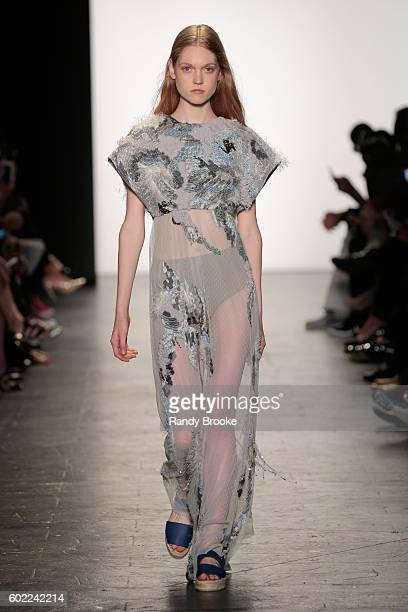 A model walks the runway at the Academy of Art University Spring 2017 Collectuons during New York Fashion Week at The Arc Skylight at Moynihan...
