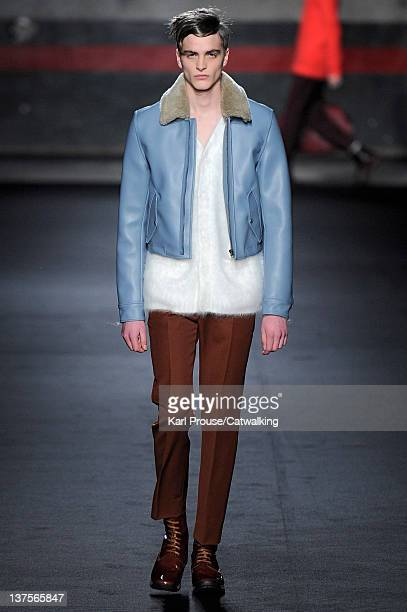 A model walks the runway at the Acne Autumn Winter 2012 fashion show during Paris Menswear Fashion Week on January 22 2012 in Paris France