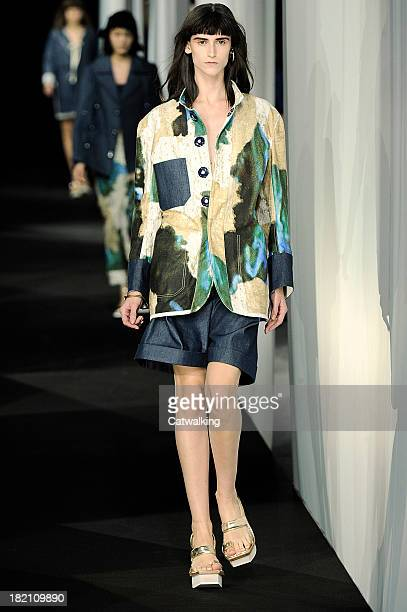 A model walks the runway at the Acne Studios Spring Summer 2014 fashion show during Paris Fashion Week on September 28 2013 in Paris France