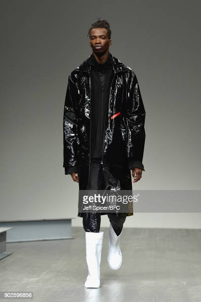 Model walks the runway at the A-COLD-WALL show during London Fashion Week Men's January 2018 at BFC Show Space on January 8, 2018 in London, England.