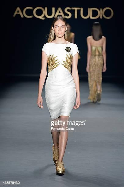 A model walks the runway at the Acquastudio fashion show during Sao Paulo Fashion Week Winter 2015 at Parque Candido Portinari on November 7 2014 in...