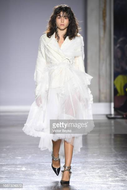 A model walks the runway at the Act n1 show during Milan Fashion Week Spring/Summer 2019 on September 21 2018 in Milan Italy