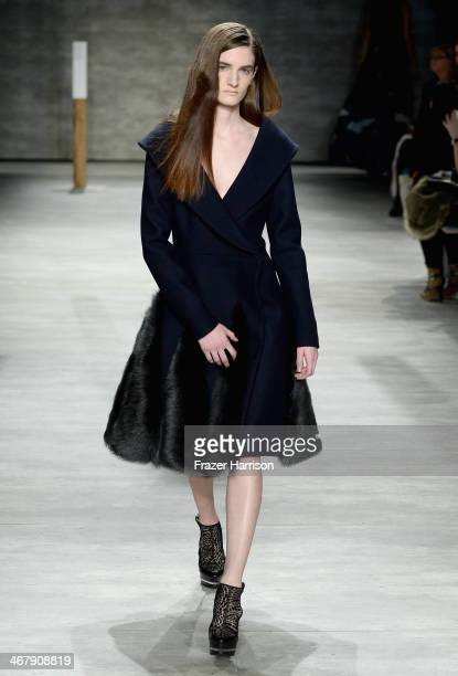 Model walks the runway at the Adeam fashion show during Mercedes-Benz Fashion Week Fall 2014 at The Pavilion at Lincoln Center on February 8, 2014 in...