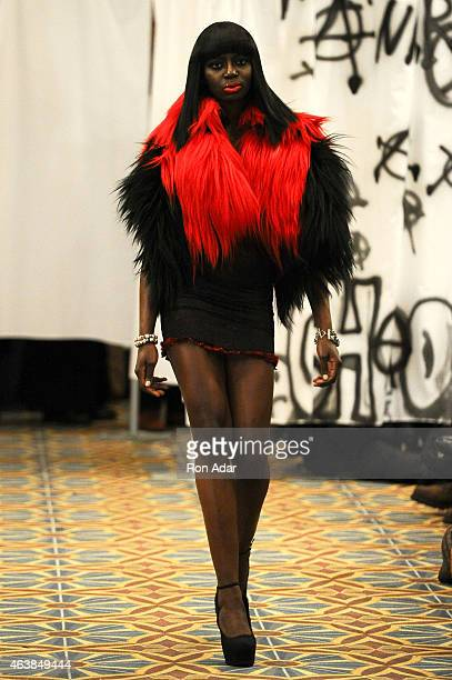 A model walks the runway at the Adrian Alicea show during the MercedesBenz Fashion Week Fall 2015 at Hotel Pennsylvania on February 18 2015 in New...