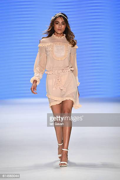 A model walks the runway at the Afffair show during MercedesBenz Fashion Week Istanbul at Zorlu Center on October 14 2016 in Istanbul Turkey