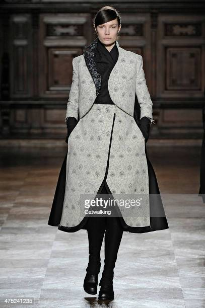 A model walks the runway at the Aganovich Autumn Winter 2014 fashion show during Paris Fashion Week on February 25 2014 in Paris France