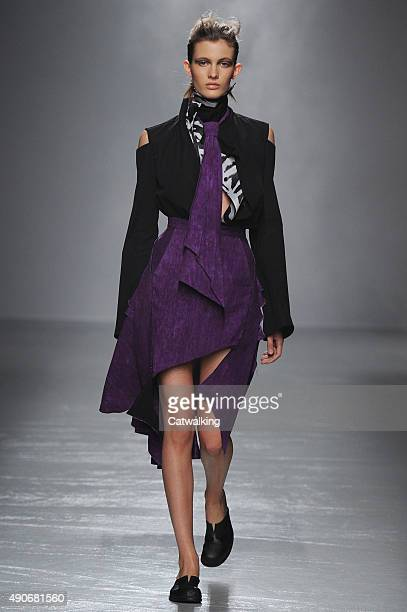 A model walks the runway at the Aganovich Spring Summer 2016 fashion show during Paris Fashion Week on September 30 2015 in Paris France