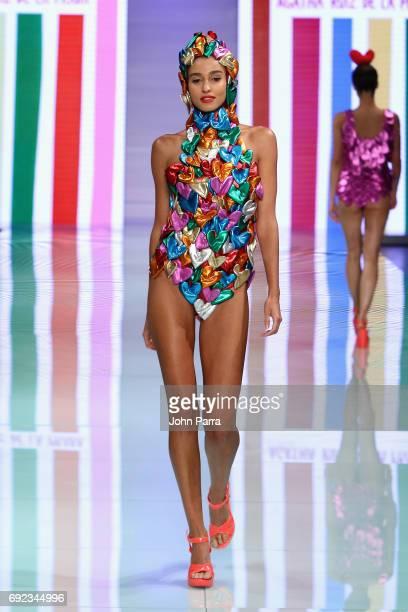 Model walks the runway at the Agatha Ruiz de la Prada fashion show at Miami Fashion Week at Ice Palace Film Studios on June 4, 2017 in Miami, Florida.