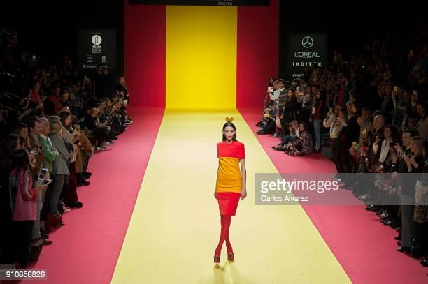 A model walks the runway at the Agatha Ruiz De La Prada fashion show during the Mercedes Benz Fashion Week Autumn/Winter 2018 at Ifema on January 26...