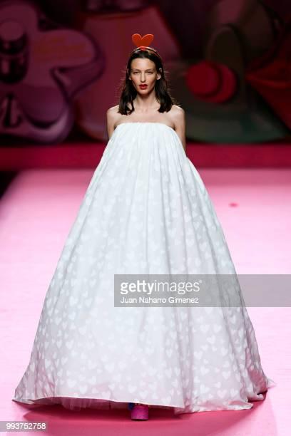 Model walks the runway at the Agatha Ruiz de la Prada show during the Mercedes-Benz Fashion Week Madrid Spring/Summer 2019 at IFEMA on July 8, 2018...
