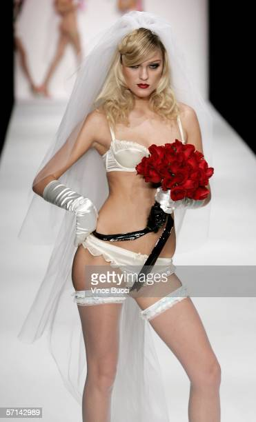A model walks the runway at the Agent Provocateur Fall 2006 show during MercedesBenz Fashion Week at Smashbox Studios on March 20 2006 in Culver City...