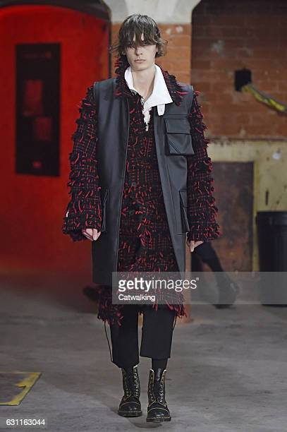 Model walks the runway at the Agi & Sam Autumn Winter 2017 fashion show during London Menswear Fashion Week on January 7, 2017 in London, United...