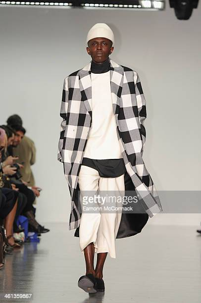 Model walks the runway at the Agi & Sam show during The London Collections: Men Autumn/Winter 2014 on January 8, 2014 in London, England.