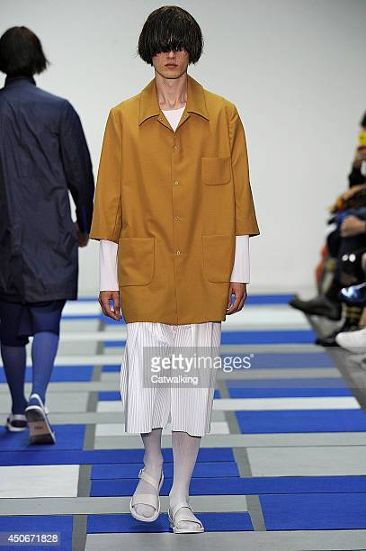 Model walks the runway at the Agi & Sam Spring Summer 2015 fashion show during London Menswear Fashion Week on June 15, 2014 in London, United...