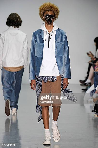 Model walks the runway at the Agi & Sam Spring Summer 2016 fashion show during London Menswear Fashion Week on June 13, 2015 in London, United...