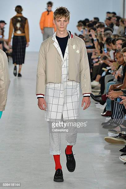 Model walks the runway at the Agi & Sam Spring Summer 2017 fashion show during London Menswear Fashion Week on June 11, 2016 in London, United...