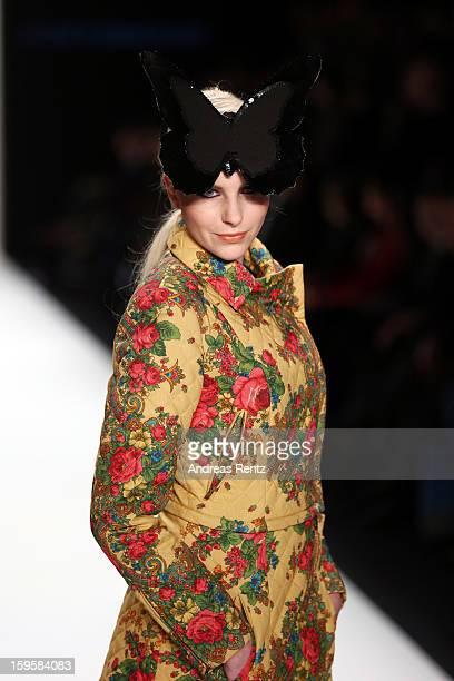 A model walks the runway at the Agne Kuzmickaite Igrida Zabere Kaetlin Kaljuvee Autumn/Winter 2013/14 fashion show during MercedesBenz Fashion Week...