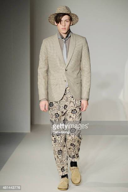 Model walks the runway at the Agnes b Spring Summer 2015 fashion show during Paris Menswear Fashion Week on June 29, 2014 in Paris, France.