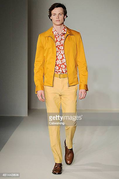 A model walks the runway at the Agnes b Spring Summer 2015 fashion show during Paris Menswear Fashion Week on June 29 2014 in Paris France